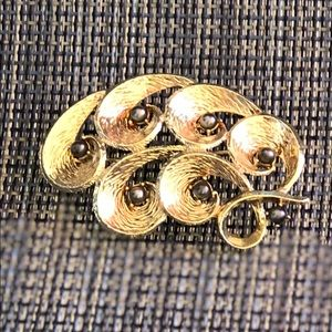Gold tone brooch